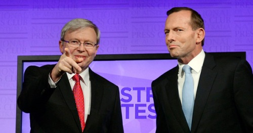 Australia's Prime Minister Kevin Rudd, left, and opposition leader Tony Abbott pose during the Leaders Debate, ahead of the Sept. 7, election,  at the National Press Club in Canberra on Sunday Aug. 11, 2013. Australian's will go to the polls on Sept. 7, 2013 during the Federal election to choose the 44th Parliament of Australia.(AP Photo/Alan Porritt, Pool)